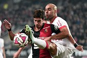Rennes' French midfielder Vincent Pajot vies with Monaco's Tunisian defender Aymen Abdennour during the French L1 football match Rennes against...