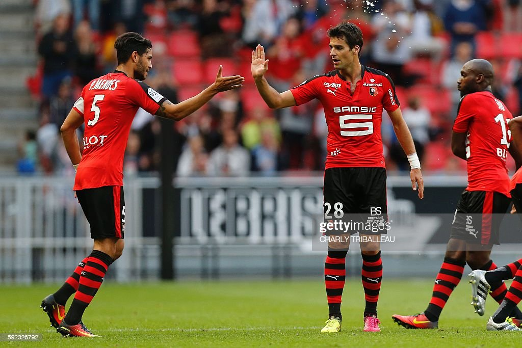 Rennes' French midfielder Yoann Gourcuff celebrates with his teammates after scoring a goal during the French L1 football match between Stade Rennais...