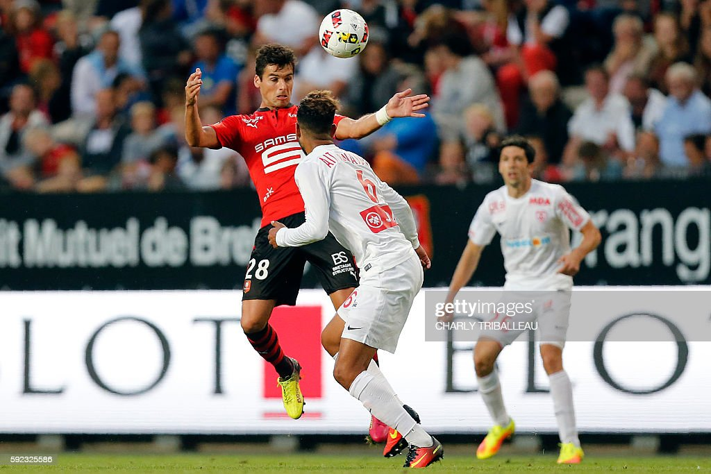 Rennes' French midfielder Yoann Gourcuff vies for the ball with Nancy's French midfielder Youssef Aït Bennasser during the French L1 football match...