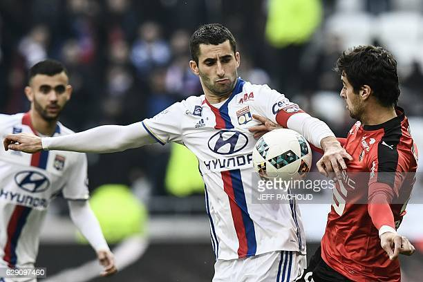 Rennes' French midfielder Yoann Gourcuff vies with Lyon's French midfielder Maxime Gonalons during the French L1 football match Olympique Lyonnais vs...