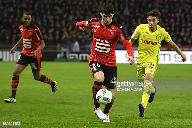 Rennes' French midfielder Yoann Gourcuff vies with Nantes' French midfielder Amine Harit during the French L1 football match between Rennes and...