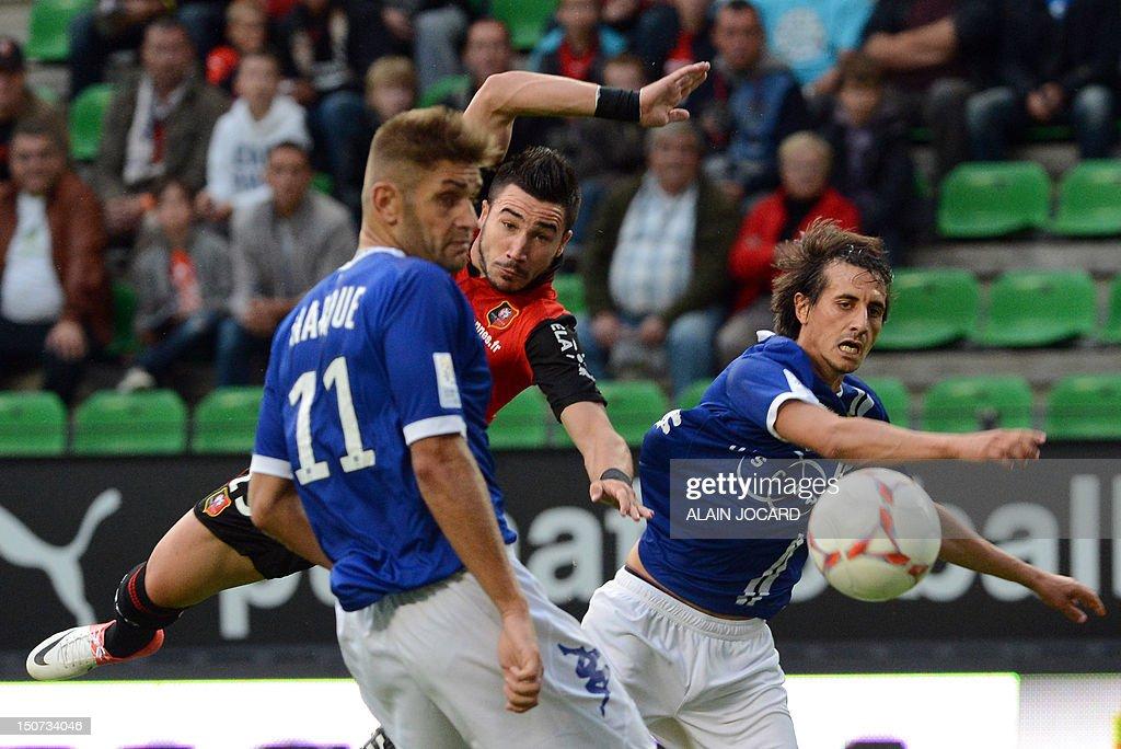 Renne's French striker Romain Alessandrini tries to score despite Bastia's French defender Francois Marque and Algerian defender Fethi Harek during...