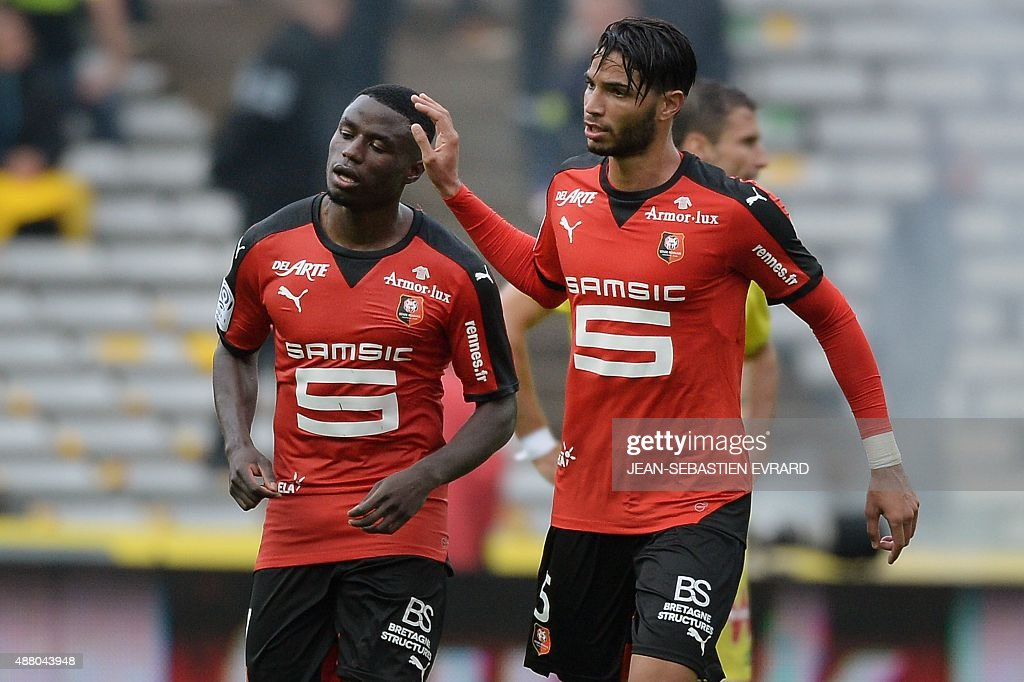 Rennes' FrenchCameroonian forward PaulGeorges Ntep is congratulated by Rennes' Portuguese defender Pedro Teodosio Mendes after scoring a goal during...