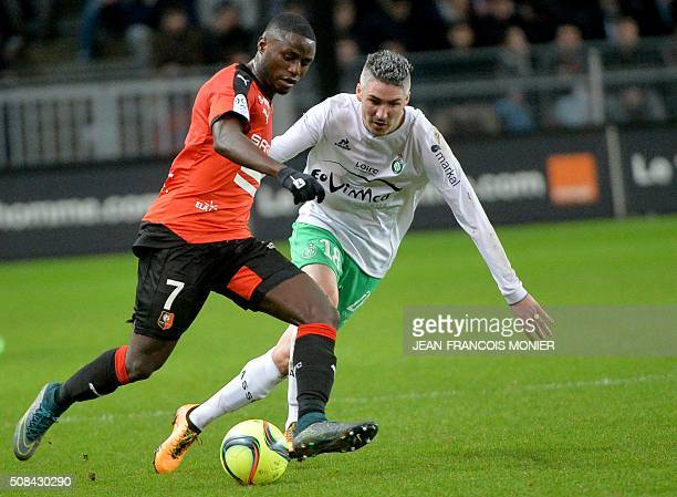 Rennes' FrenchCameroonian forward PaulGeorges Ntep vies for the ball with SaintEtienne's French midfielder Fabien Lemoine during the French L1...