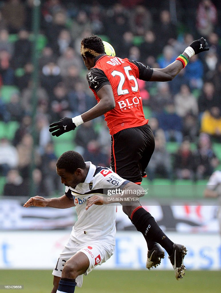 Rennes' Ghanaian defender John Boye (up) fights for the ball with Sochaux' French forward Giovanni Sio during the French L1 football match Rennes against Sochaux on February 23, 2013 at the route de Lorient stadium in Rennes, western France.