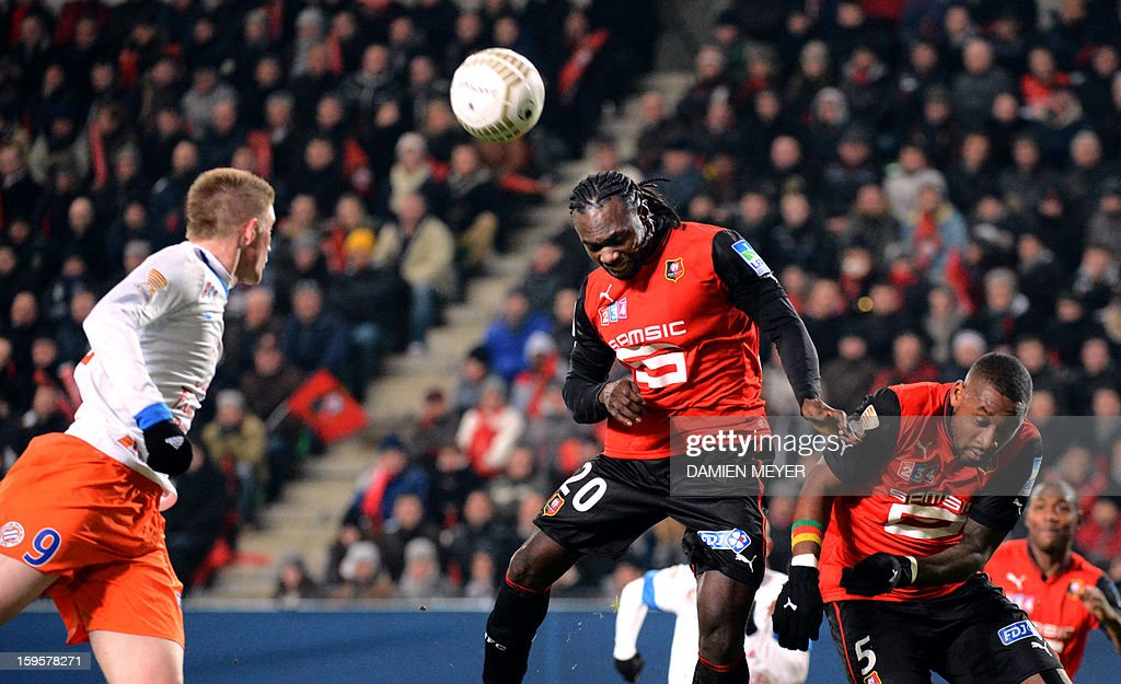 Rennes' Ghaniaan defender John Mensah (C) heads the ball during a French League Cup semifinal football match between Rennes and Montpellier on January 16, 2013 at the route de Lorient stadium in Rennes, western France.