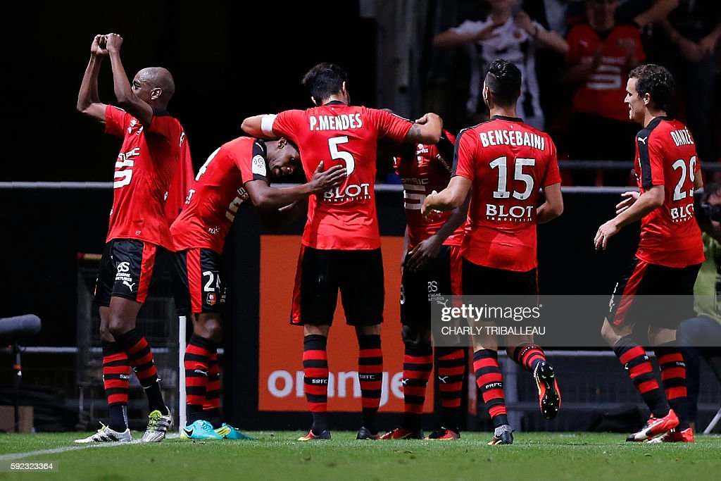 Rennes' Ivorian forward Giovanni Sio celebrates with teammates after scoring a goal during the French L1 football match between Stade Rennais FC and...