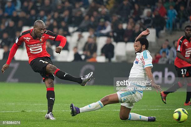 Rennes' Ivorian forward Giovanni Sio scores despite Marseille's Portugese defender Jorge Pires de Fonseca Rolando during the French L1 football match...