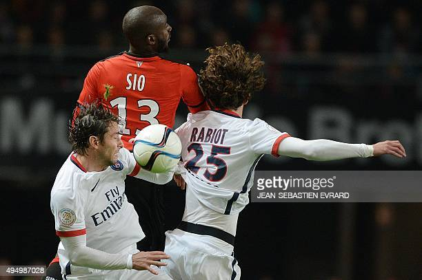Rennes' Ivorian forward Giovanni Sio vies with Paris SaintGermain's Brazilian defender Maxwell and Paris SaintGermain's French midfielder Adrien...