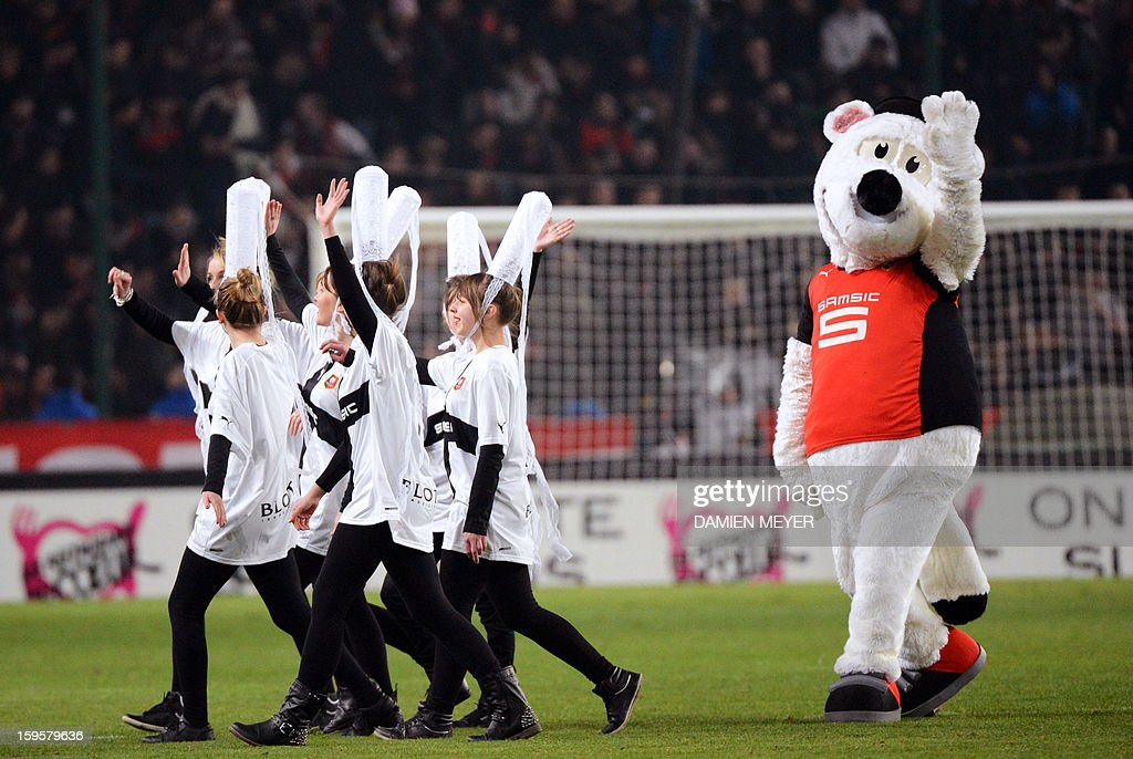 Rennes' mascott and cheerleaders wave to the crowd during the French League Cup semifinal football match Rennes against Montpellier on January 16, 2013 at the route de Lorient stadium in Rennes, western France.