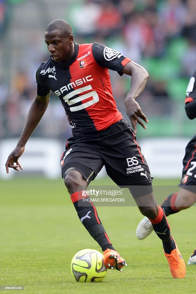 Rennes' midfielder Abdoulaye Doucoure runs with the ball during the French L1 football match between Rennes and Guingamp on April 12, 2015 at the route de Lorient stadium in Rennes, western France.
