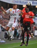 Rennes' midfielder Fabien Lemoine and forward Ismael Bangoura vie with BoulognesurMer's Johan Ramare during their French L1 football match on August...