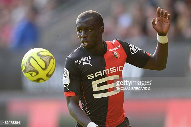 Rennes' midfileder Abdoulaye Doucoure eyes the ball during the French L1 football match between Rennes and Guingamp on April 12 2015 at the Route de...