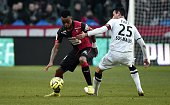 Rennes' Mozambican defender Edson Mexer vies with Caen's French midfielder Julien Feret during the French L1 football match Rennes against Caen at...
