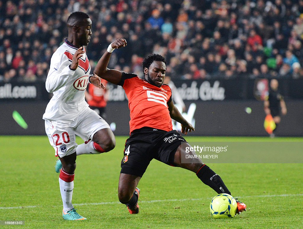 Rennes' Nigerian defender Onyekachi Apam (R) vies for the ball with Bordeaux's French forward Henri Saivet during the French L1 football match between Rennes and Bordeaux on January 12, 2013, at the Route de Lorient stadium in Rennes, western France.