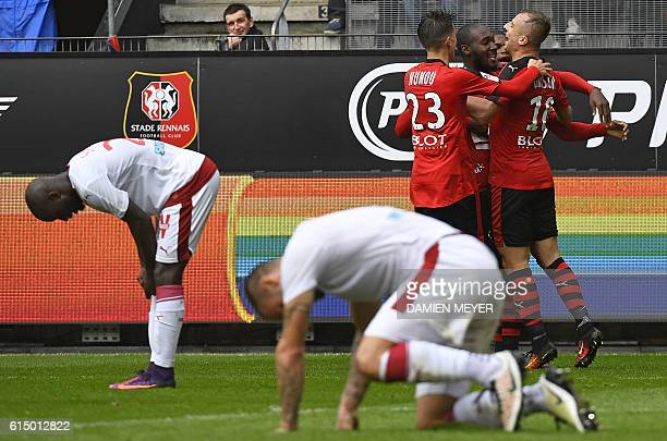 Rennes players celebrate after a Bordeaux player scored against his team during the French L1 football match between Rennes and Girondins de Bordeaux...