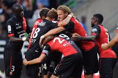 Rennes' players celebrate after a goal during the French L1 football match between Stade Rennais FC and EvianThonon Gaillard FC on August 16 2014 at...