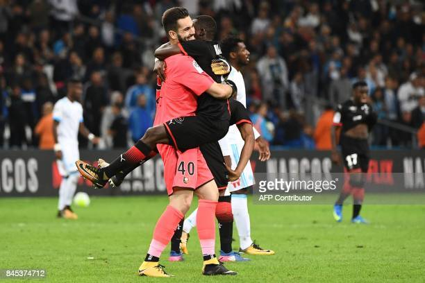 Rennes' players celebrate after winning the French L1 football match Olympique of Marseille versus Stade Rennais FC at the Velodrome stadium in...