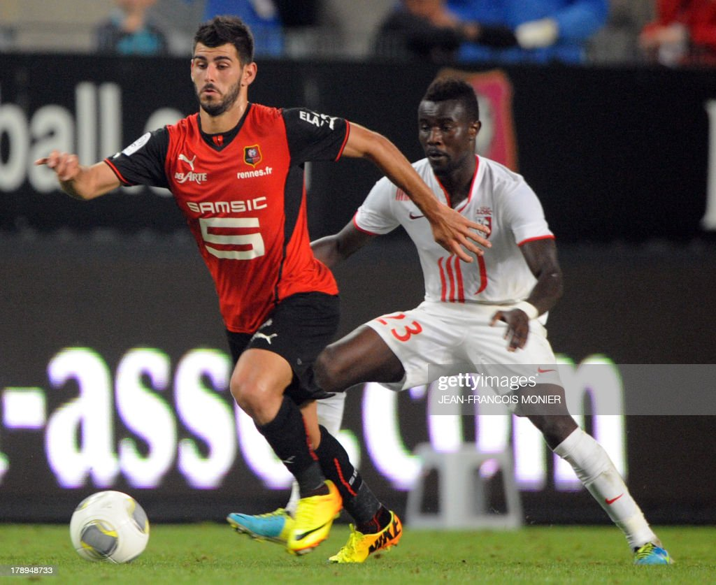 Rennes' Portuguese forward Nelson Oliveira (L) vies with Lille's Senegalese defender Pape Souare (R) during the French L1 football match Rennes (SRFC) vs Lille (LOSC) on August 31, 2013 at the Route de Lorient stadium in Rennes, western France.