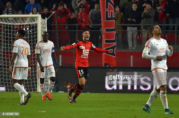 Rennes' Ramy Bensebaini celebrates after winning the French League Cup football match between Rennes and Lorient on October 26 2016 at the Roazhon...