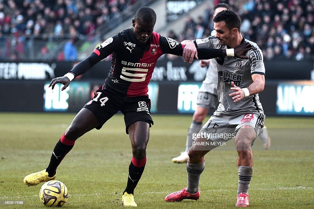 Rennes' Senegalese forward Fallou Diagne (L) vies with Marseille's French defender <a gi-track='captionPersonalityLinkClicked' href=/galleries/search?phrase=Jeremy+Morel&family=editorial&specificpeople=650503 ng-click='$event.stopPropagation()'>Jeremy Morel</a> during the French L1 football match Rennes against Marseille on February 7, 2015 at the Route de Lorient stadium in Rennes, western France.