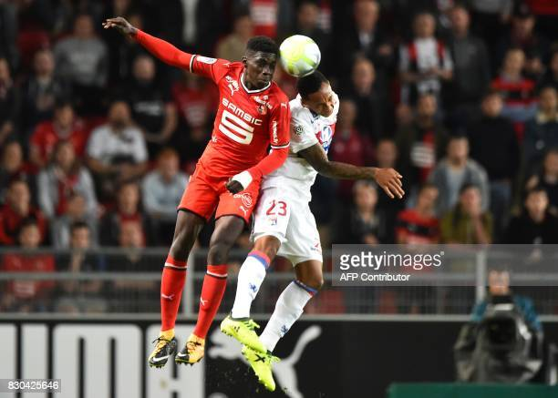 Rennes' Senegalese forward Ismaila Sarr vies for the ball with Lyon's Dutch defender Kenny Tete during the French L1 football match between Stade...