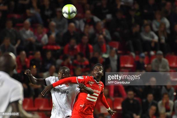 Rennes' Senegalese forward Ismaila Sarr vies with Dijon's defender Cedric Yambere during the French L1 football match between Rennes and Dijon at the...