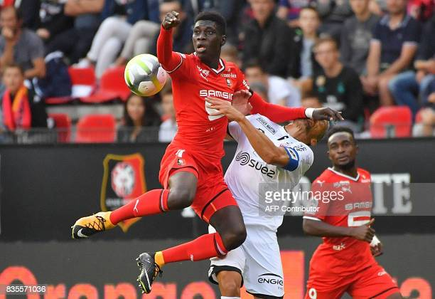 Rennes' Senegalese forward Ismaila Sarr vies with Dijon's French defender Cedric Varrault during the French L1 football match between Rennes and...