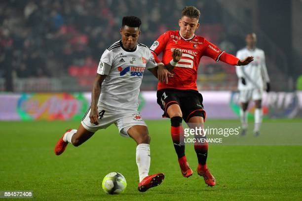 Rennes' Spanish forward Thomas Brandon vies with Amien's SouthAfrican midfielder Bongani Zungu during the French Ligue 1 football match between...