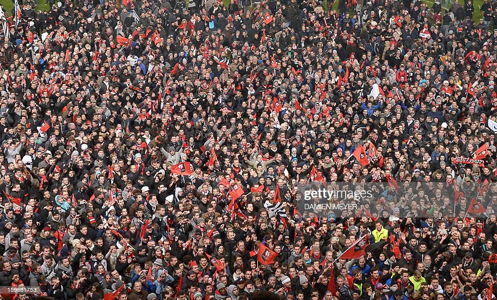Rennes' supporters celebrate on the pitch after Rennes won 2-0 a French League Cup semifinal football match between Rennes and Montpellier on January 16, 2013 at the route de Lorient stadium in Rennes, western France.