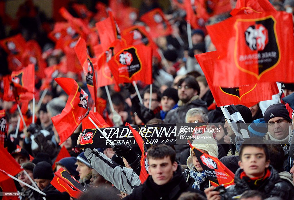 Rennes' supporters wave flags and scarfs during a French League Cup semifinal football match betwwen Rennes and Montpellier on January 16, 2013 at the route de Lorient stadium in Rennes, western France.