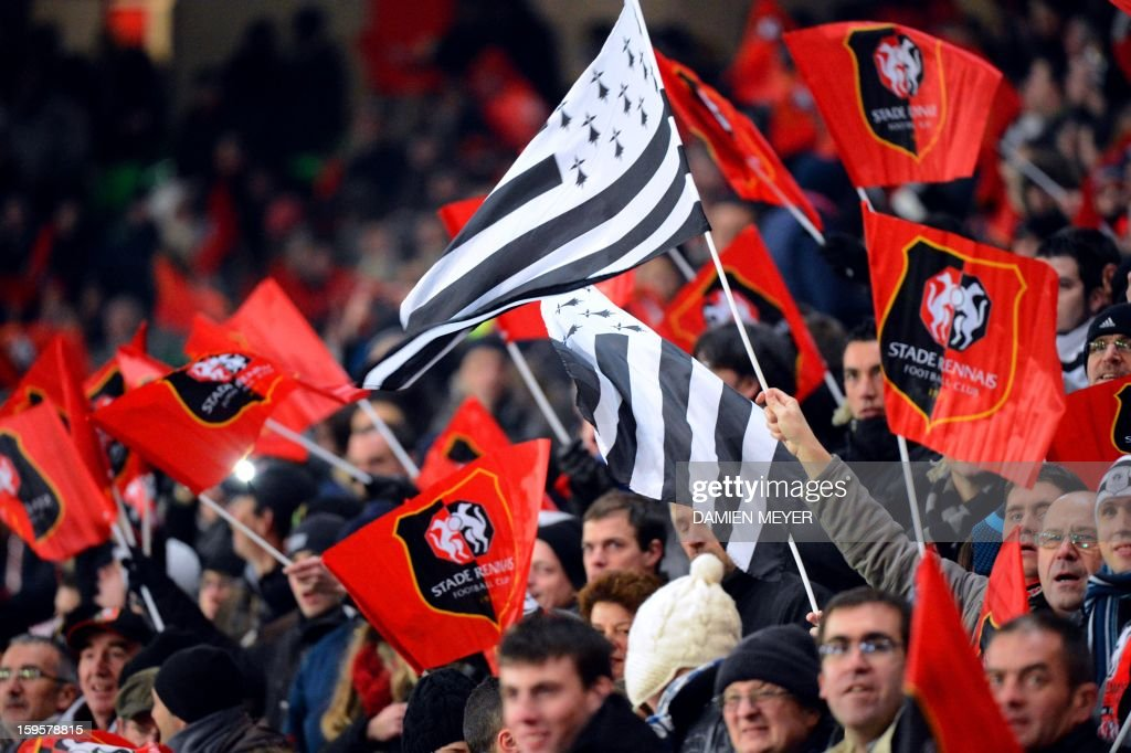 Rennes' supporters wave flags during a French League Cup semifinal football match between Rennes and Montpellier on January 16, 2013 at the route de Lorient stadium in Rennes, western France.