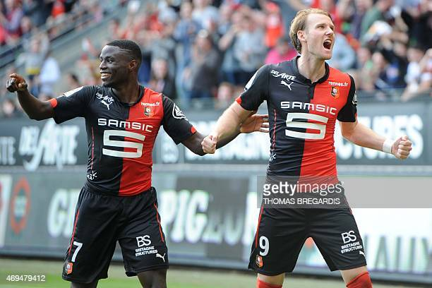 Rennes' Swedish forward Ola Toivonen celebrates with PaulGeorges Ntep after scoring a goal during the French L1 football match between Rennes and...