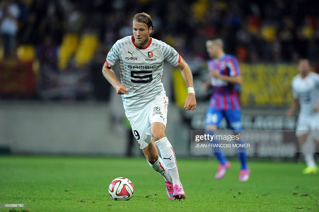 Rennes' Swedish forward Ola Toivonen runs with the ball during the French L1 football match between Caen and Stade Rennais on August 30 at the...