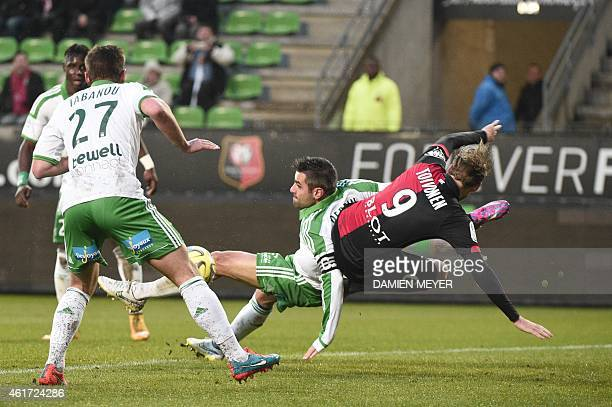 Rennes' Swedish forward Ola Toivonen vies with SaintEtienne's French defender Loic Perrin during the French L1 football match Rennes vs SaintEtienne...