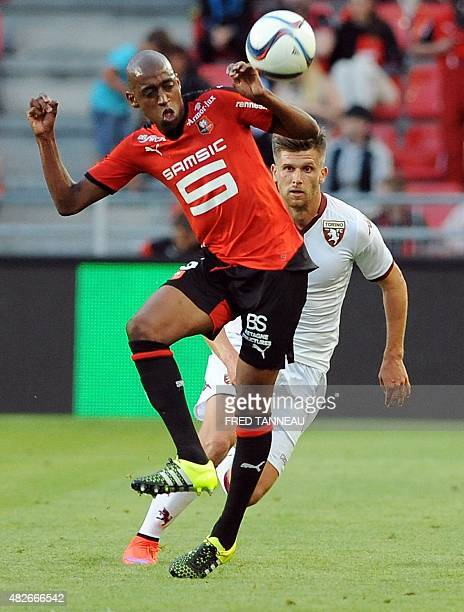 Rennes' Swiss midfielder Gelson Fernandes challenges Torino's Serbian midfielder Alen Stevanovic during a friendly football match between Rennes and...