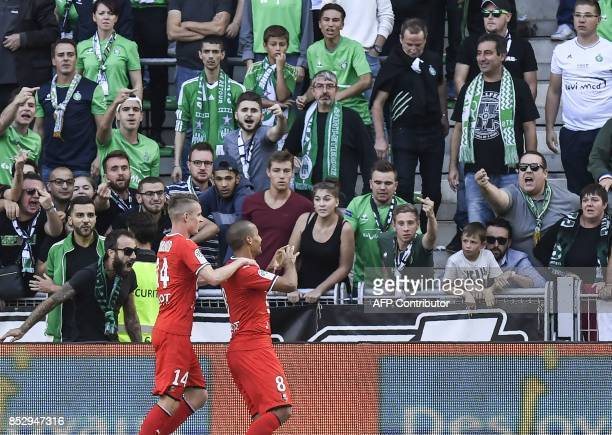 Rennes' Tunisian midfielder Wahbi Khazri celebrates after scoring a goal during the French Ligue 1 football match AS SaintEtienne versus Stade...