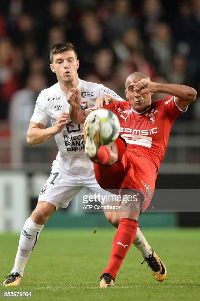 Rennes' Tunisian midfielder Wahbi Khazri vies Rennes' French midfielder Benjamin Andre during the French L1 football match between Stade Rennais and...