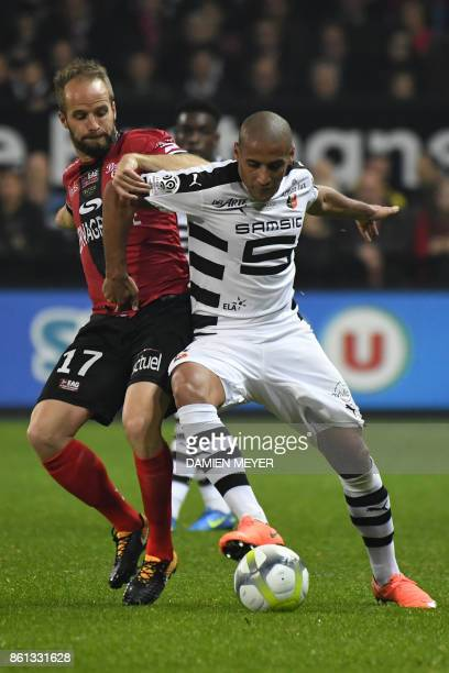 Rennes' Tunisian midfielder Wahbi Khazri vies with Guincamp's French midfielder Etienne Didot during the French Ligue 1 football match Guingamp...