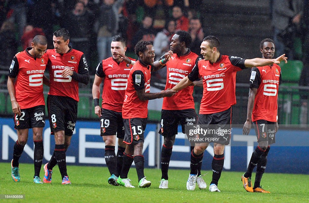 Rennes' Turkish forward Mevlut Erding (2ndR) celebrates with teammates after scoring during the French L1 football match Rennes vs Montpellier on October 20, 2012 at the Route de Lorient Stadium in Rennes, western France.