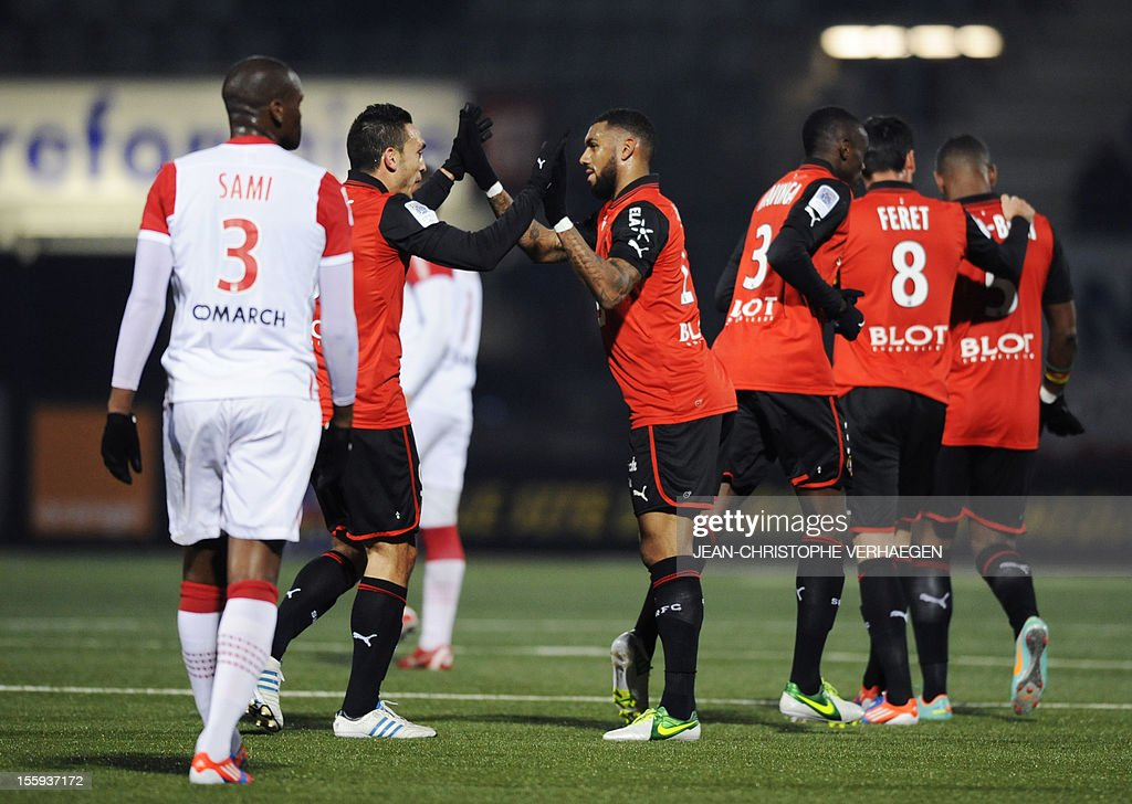 Rennes' Turkish forward Mevlut Erding (2ndL) is congratulated by Rennes' French midfielder Yann Mvila (C) after scoring during their French L1 football match Nancy (ASNL) vs Rennes (SRFC) at Marcel Picot Stadium, on November 9, 2012, in Tomblaine.
