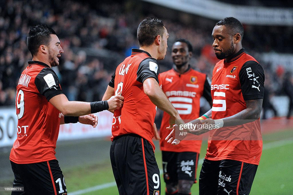 Rennes' Turkish forward Mevlut Erding (C) is congratulated by team mates Romain Alessandrini and Jean Armel Kana-Biyik (R) after scoring a goal during a French L1 football match Stade Rennais vs Reims on November 3, 2012 at the Route de Lorient stadium in Rennes.