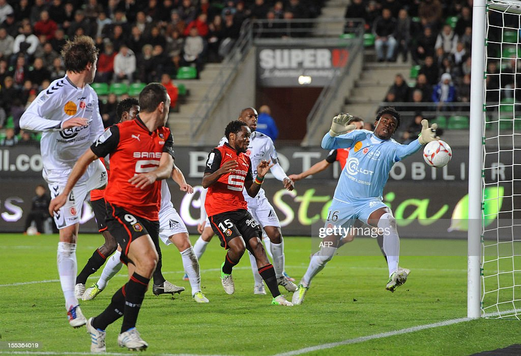 Rennes' Turkish forward Mevlut Erding (L) scores during the French L1 football match Stade Rennais FC vs Stade de Reims on November 3, 2012 at the route de Lorient stadium in Rennes, western France.