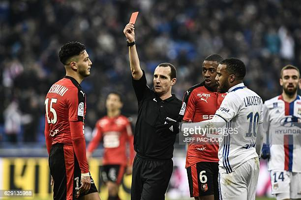 Rennes'Algeria defender Ramy Bensebaini receives a red card from French referee Benoit Millot during the French L1 football match Olympique Lyonnais...
