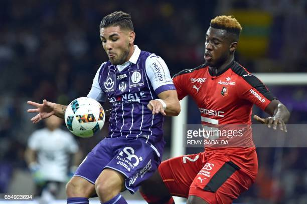 Rennes's defender Joris Gnagnon defends against Toulouses's forward Andy Delort during the French L1 football match Toulouse vs Rennes on March 18...