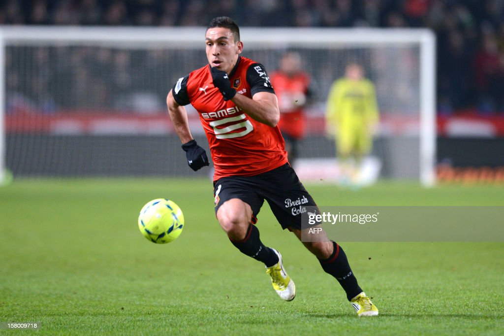 Rennes's forward Mevlut Erding runs with the ball during the French L1 football match Rennes versus Brest on December 8, 2012 at Route de Lorient stadium in Rennes, western France.