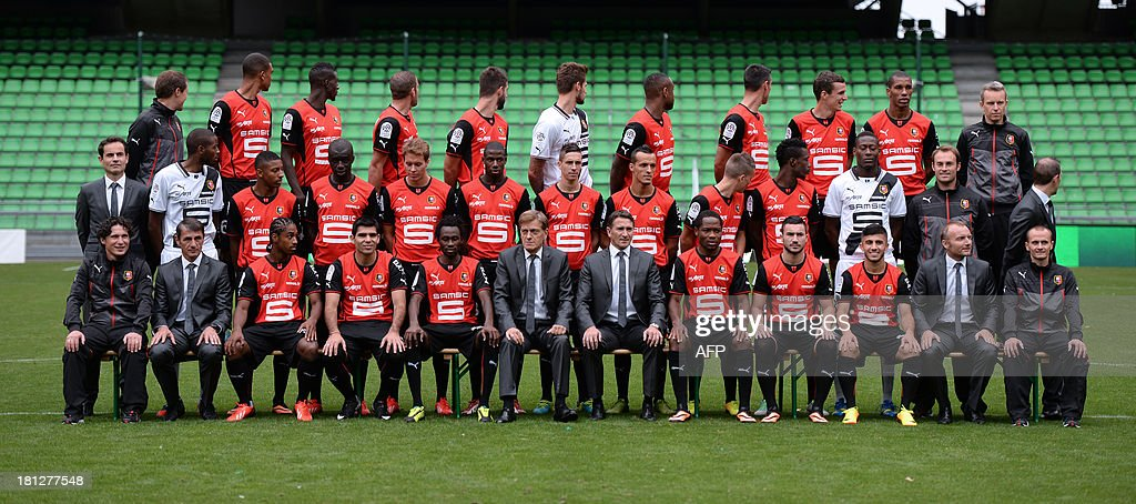 Rennes's players and staff pose at the route de Lorient stadium in Rennes, western France, on September 19, 2013. First row seated (L-R) Laurent Huard (french coach' CFA group), Michel Troin (french assistant coach), french forward Wesley Said, argentine forward Silvio Romero, burkina-faso forward Jonathan Pitroipa, Frdric de Saint-Sernin (french president), Philippe Montanier (french coach), cameroonian midfielder Jean II Makoun, french forward Romain Alessandrini, french midfielder Zana Allee, Karl Chaory (french doctor), Geoffrey Van Overschelde (french physiotherapist). second row (L-R) Jean-Francois Creac'h Cadec (french director of the activities), french goalkeeper Abdoulaye Diallo, french defender Steven Moreira, senegalese defender Cheikh M'bengue, norwegian midfielder Anders Konradsen, french midfielder Abdoulaye Doucoure, french midfielder Vincent Pajot, algerien midfielder Foued Kadir, french midfielder Adrien Hunou, ghaneen defender John Boye, senegalese goalkeeper Cheikh N'diaye, Christophe Revel (french goalkeeper coach), Elouan Vivier (french sports coordinator assistant). third row (L-R) Jocelyn Courtois (french physiotherapist), french defender Cdric Hountondji, french defender Tiemoue Bakayoko, french defender Sylvain Armand, portuguese forward Nelson Oliveira, french goalkeeper Benoit Costil, cameroonian defender Jean-Armel Kana-Biyik, french midfielder Julien Feret, french defender Romain Danze, bresilien defender Da Conceicao Emerson, Yannick Logeais (french physiotherapist).