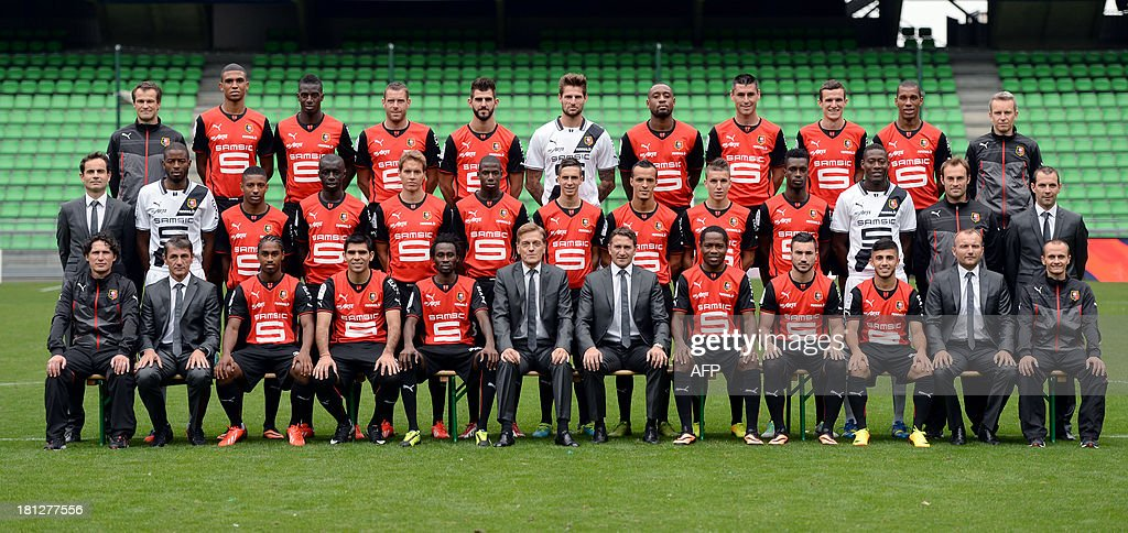 Rennes's players and staff pose for at the route de Lorient stadium in Rennes, west of France, on September 19, 2013. First row seated (L-R) Laurent Huard (french coach' CFA group), Michel Troin (french assistant coach), french forward Wesley Said, argentine forward Silvio Romero, burkina-faso forward Jonathan Pitroipa, Frdric de Saint-Sernin (french president), Philippe Montanier (french coach), cameroonian midfielder Jean II Makoun, french forward Romain Alessandrini, french midfielder Zana Allee, Karl Chaory (french doctor), Geoffrey Van Overschelde (french physiotherapist). second row (L-R) Jean-Francois Creac'h Cadec (french director of the activities), french goalkeeper Abdoulaye Diallo, french defender Steven Moreira, senegalese defender Cheikh M'bengue, norwegian midfielder Anders Konradsen, french midfielder Abdoulaye Doucoure, french midfielder Vincent Pajot, algerien midfielder Foued Kadir, french midfielder Adrien Hunou, ghaneen defender John Boye, senegalese goalkeeper Cheikh N'diaye, Christophe Revel (french goalkeeper coach), Elouan Vivier (french sports coordinator assistant). third row (L-R) Jocelyn Courtois (french physiotherapist), french defender Cdric Hountondji, french defender Tiemoue Bakayoko, french defender Sylvain Armand, portuguese forward Nelson Oliveira, french goalkeeper Benoit Costil, cameroonian defender Jean-Armel Kana-Biyik, french midfielder Julien Feret, french defender Romain Danze, bresilien defender Da Conceicao Emerson, Yannick Logeais (french physiotherapist).