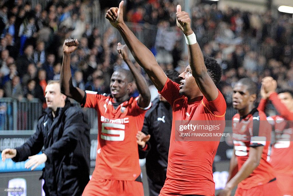 Rennes's players celebrate after the French L1 football match between Angers and Rennes on November 6 2015 at the Jean Bouin stadium in Angers...
