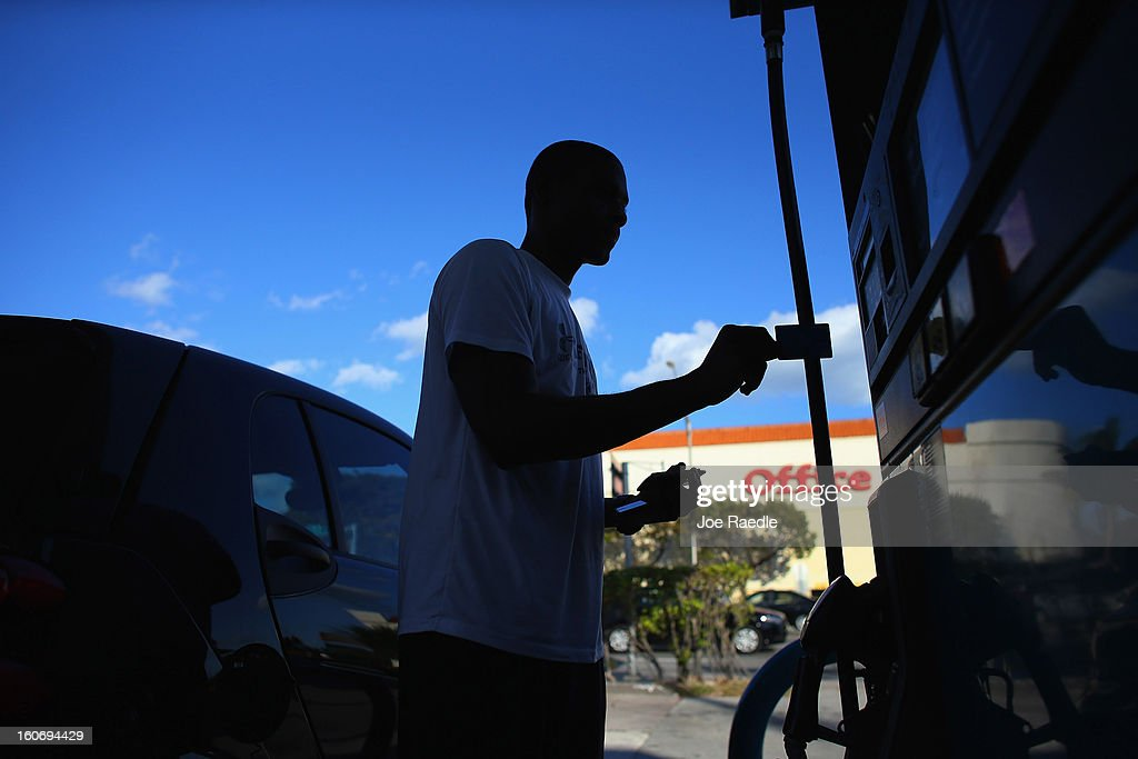 Rennie Valius uses a gas station's pump to fill his vehicle with gas on February 4, 2013 in Miami, Florida. Reports indicate that gas pump prices are at their highest level on record for this period of the year and may be an indication that the year ahead may see even higher records.